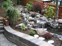 flower design city garden ideas tiered with waterfall and seating