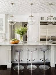 stools for island in kitchen stunning monochromatic white kitchen features three clear acrylic