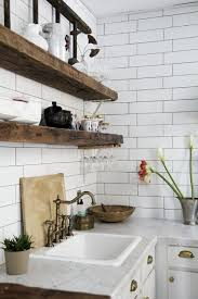 rustic shelves white subway tile grey white marble counters