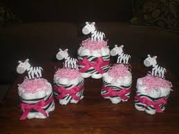 Diaper Cake Centerpieces zebra and pink mini and bundt diaper cakes and bootie