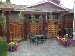 pergola divider with stamped concrete patio using owt hardware