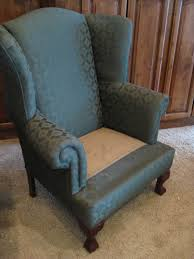 pair of wingbacks and a round ottoman slipcovers by shelley