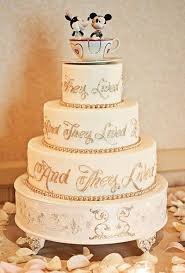 disney wedding cake inscribed with the classic storybook end