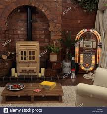 Living Room Pallet Table Vintage Cream Stove And A Jukebox In A Living Room With An Old