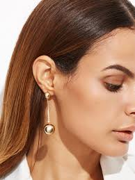 mismatched earrings trend everyone is giving these gaudy earring trends a go this year