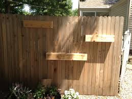 unfinished diy fence mounted garden planter boxes in the side yard