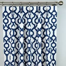 pair of pinch pleat top curtains in navy blue and white lyon