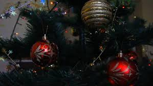 christmas video green artificial christmas tree a female hand