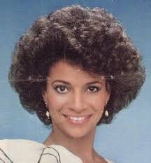 hairstyles in 1983 high bouffant a neat twist in back rest brushed up lightly