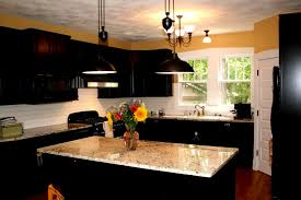 granite countertop unfinished cabinets kitchen subway tile