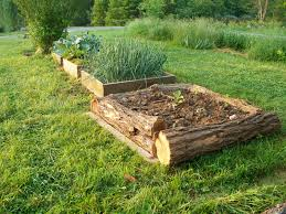 Landscape Flower Bed Ideas by Rough Hewn Logs Provide Walls For A Raised Bed While Blending In