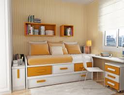 bedroom fancy orange sheet trundle bed and white furry rug in