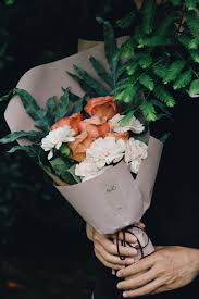 paper wrapped flowers paper wrapped bouquet photo by lizzie amianyuhua on unsplash