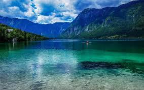slovenia lake slovenia beautiful nature lake mountains clouds boats