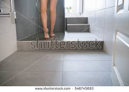 Modern Tiled Bathrooms - low angle view bare legs young stock photo 546745693 shutterstock