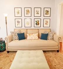 design dilemma what to hang on the big wall behind your sofa