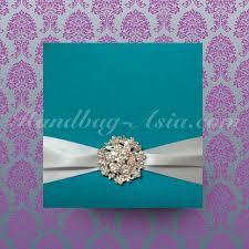 asian hand ring holder images Aqua blue silk invitation holder with round flower brooch jpg