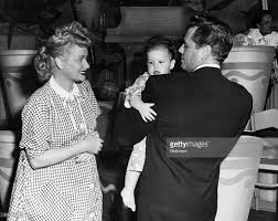 lucille ball desi arnaz holding baby pictures getty images