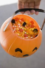halloween bowl with grabbing hand 10 things you should know before eating candy corn delish com