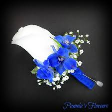 royal blue boutonniere a white size accented with blue delphinium fresh