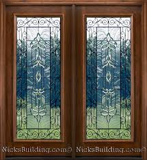 Iron Patio Doors Mahogany Patio Doors With Beveled Glass And Wrought Iron Detailing