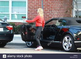 bentley red and black melanie griffith parks her black bentley before running an errand