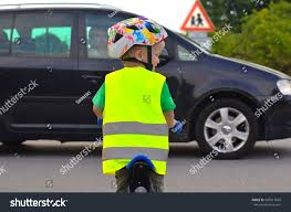 bike riding vest little boy riding bike on road stock photo 585917828 shutterstock