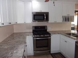 white cabinets black granite countertops white subway tile with