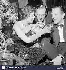 mrs eunice gayson and reg north at the room 21 christmas stock
