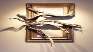 wood framed wall wood frame with grafted manzanita branch