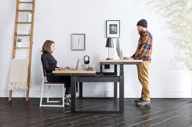 Sit Stand Desks Split Design On Sit Stand Adjustable Height Desk Lets You Do Both