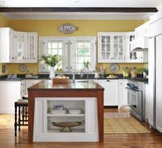 white and yellow kitchen for our house at the lake what i