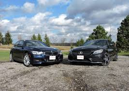2016 bmw 340i vs 2016 mercedes benz c450 amg autoguide com news