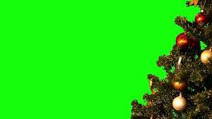 christmas tree with christmas tree decorations rotating on green
