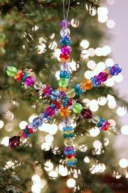 beaded snowflake ornament housing a forest