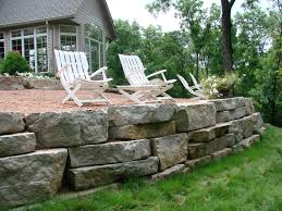 outcropping stone wall stuber land design outside pinterest