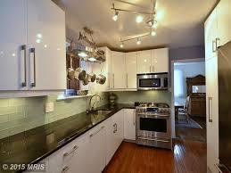 modern kitchen with hardwood floors pendant light in