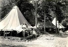 photo of girls looking out of a platform tent in allegany state