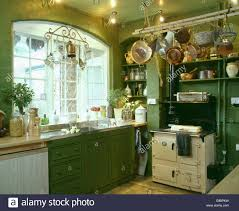 cuisine en batterie de cuisine batterie de cuisine above aga oven in traditional green