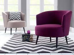 furniture purple comfy chair with curved back placed on grey