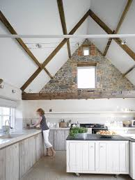 kitchen rustic kitchen with stone wall also wooden ceiling