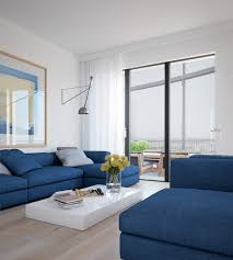 cool blue apartment bright couches with solid white coffee table
