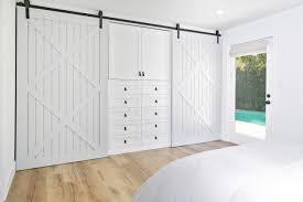 Wall To Wall Closet Doors The Master Bedroom Incorporates An Ingenious Barn Door Closet