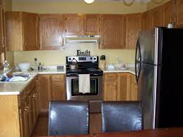 inexpensive kitchen remodel ideas cheap kitchen remodel white wooden cabinet gas range vintage wall