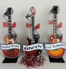 shredded mylar if you want a foamcore guitar centerpiece with glitter and