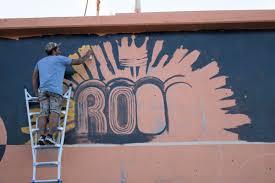 urban reno art adding beauty deterring graffiti kunr local artist joe c rock paints a mural on the back of a business during a recent art walk