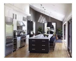 bulkhead with lighting over cabinets to deal with upward sloping