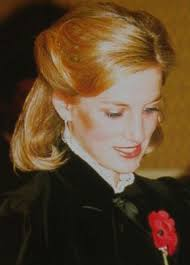 princess diana with long hair contemplating the royals