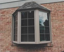 bay window basics jfk window door forest park nearsay for this bay window jfk window and door built the bay to fit within the existing window s rough opening this bay has colonial style grills and a shingled