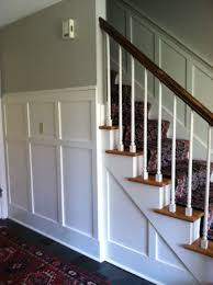 wainscoting in front hall with revere pewter and linen white paint
